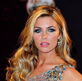 Abbey Clancy flaunts sexy pins in micro mini-skirt on morning TV show