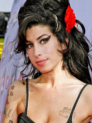 Winehouse's ashes buried