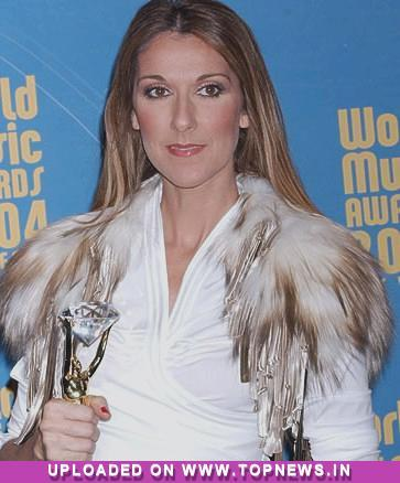 Celine Dion baptises her twin sons