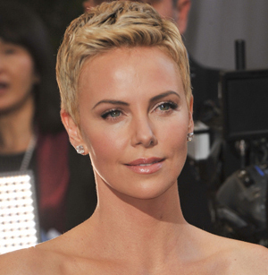 Theron helps Oscars guard after seizure?