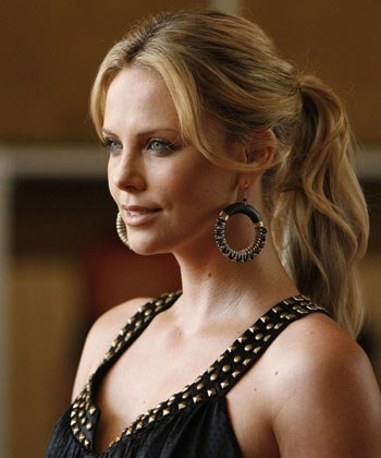 `50 Shades Of Grey`-inspired Charlize Theron poses in leather and chains