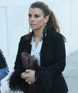 `Pregnant` Coleen Rooney flaunts toned legs at fashion show
