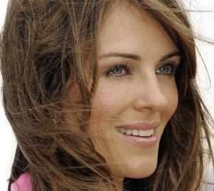 Liz Hurley tells TV reporter to `f*** off` at Perth Airport