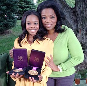 Gabby Douglas gives balance beam lessons to Oprah Winfrey on TV show