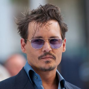 Johnny Depp says he wants to have 100 babies with fiance Amber Heard