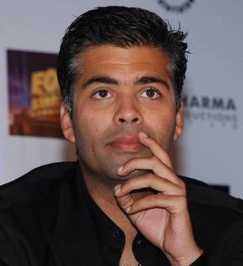 Kissing scenes help to get opening: Karan Johar
