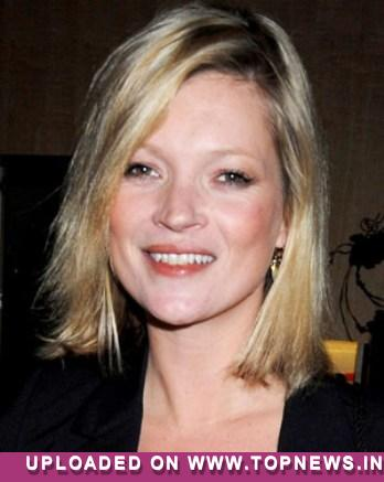 Kate Moss' dad hopes marriage will 'calm down' her hard partying ways
