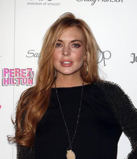 Lohan in good spirits after health scare