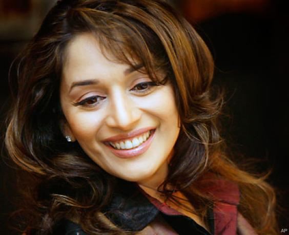 ... Madhuri and her old business manager Rakesh Nath (Rikku) ...