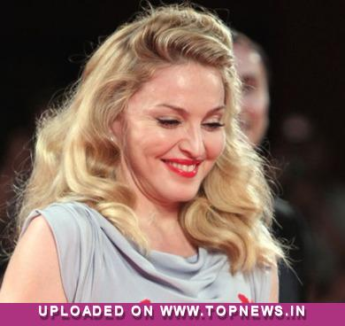 Madonna gets money thrown by fans with stripper-style performance