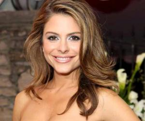... Maria Menounos kept her word by stripping down to a tiny string bikini ...