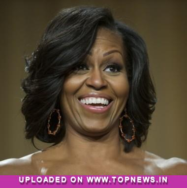 Michelle Obama debuts new bangs for 49th b'day