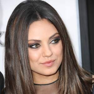 `Busy` Mila Kunis longs for home 