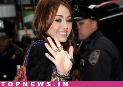 B'day girl Miley Cyrus caught making out with new beau