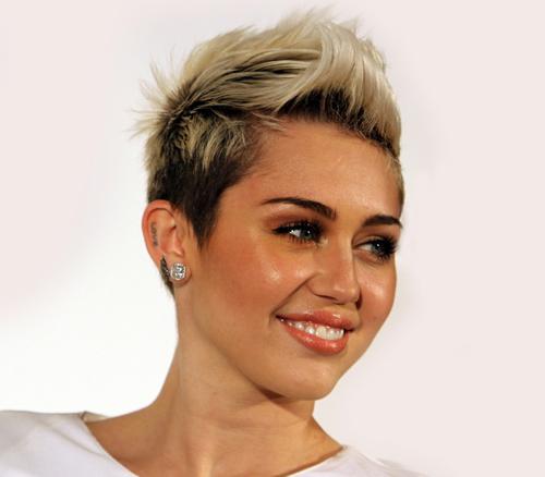 US pop singer Miley Cyrus spotted in Birmingham flaunting a Man U t-shirt