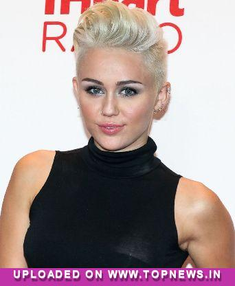 Miley Cyrus gets UK chart double