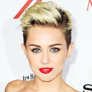 Miley Cyrus posts topless pic on Instagram while getting a haircut