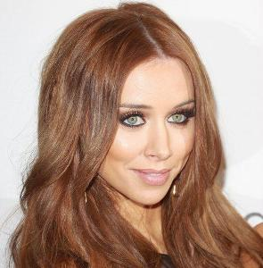 Una Healy's sheer dress gives bra and pants illusion