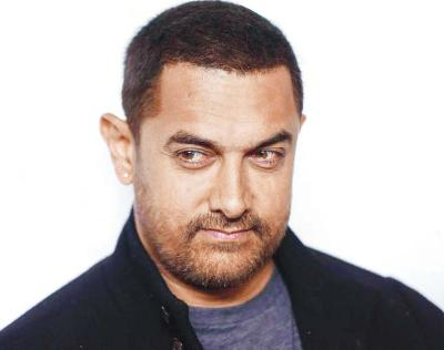 'Nervy' Aamir takes to smoking, but 'not happy about it'