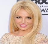 Britney Spears does 'artsy fartsy' stuff 'topless' while jamming to Mariah Carey
