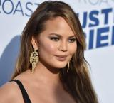 Chrissy Teigen shames 'bad racist' who attacked her