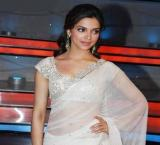 Deepika goes 'white glam' at pal's wedding