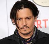 Johnny Depp bottle feeds baby bat in Jack Sparrow costume