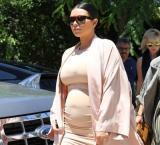 'Preggers' Kim K shows off baby bump in skintight dress