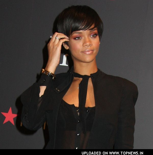 Rhianna Launches Umbrella Line in New York
