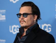 Depp thinks acting is similar to being in a band