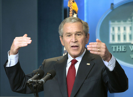 Bush says economy showing signs of improvement