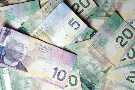 Canadian dollar rises 0.14 of a cent to 90.56