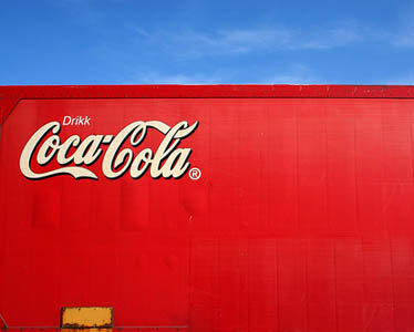Soft-drink volume up, profits down at Coca-Cola