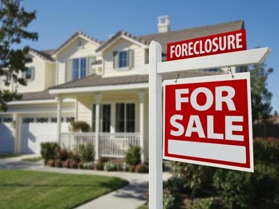 Foreclosures fell to lowest level seven years in June, report