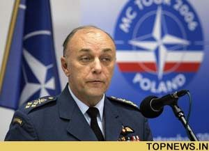 Amidst controversy, France returns to NATO military command