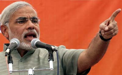 Fearing shoe-attack, Modi addresses rally surrounded by a net