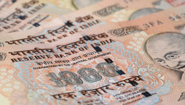 Rupee declines to reach near one-month low