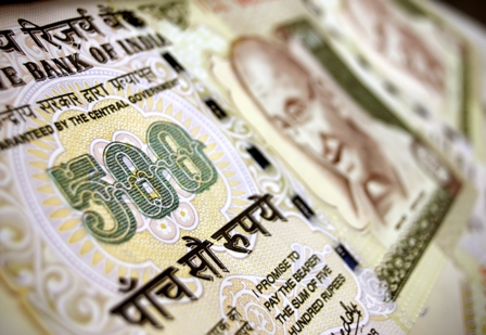 Rupee's fall being linked to RBI's dollar buying spree