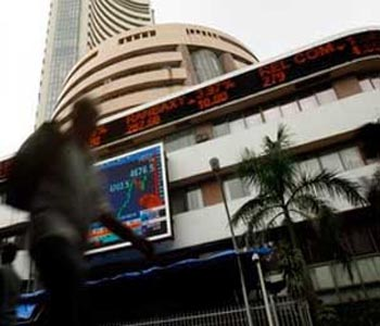 Sensex off record highs, down 105 points in early trade