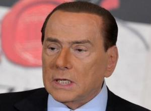 Topless women target Berlusconi as he votes in election