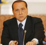 Miffed Italian PM Berlusconi threatens news blackout