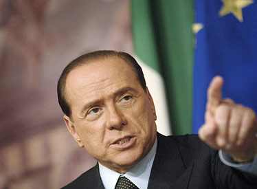 Italian Prime Minister Berlusconi bloodied by attacker