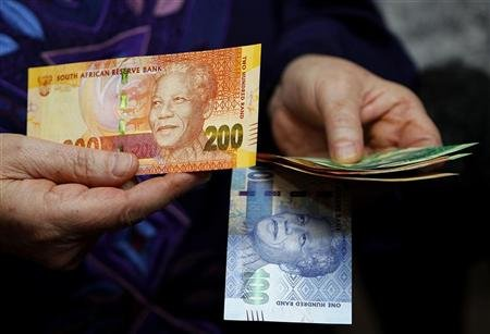 South African Rand rises to 8.4168 against US dollar