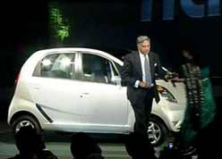 Ratan Tata unveils One Lakh Rupees car 'Nano' at the Auto Expo show in New Delhi