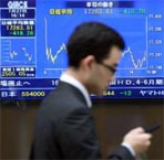 Tokyo stocks end morning mixed ahead of earnings reports