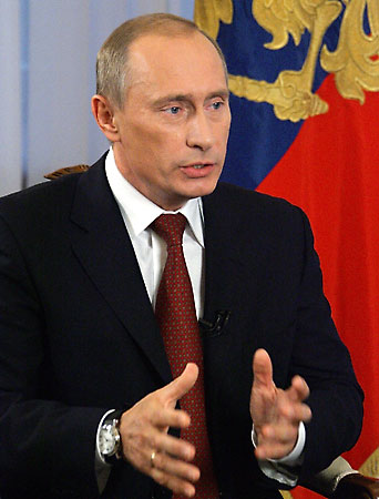 Putin writes column on retaining and firing people