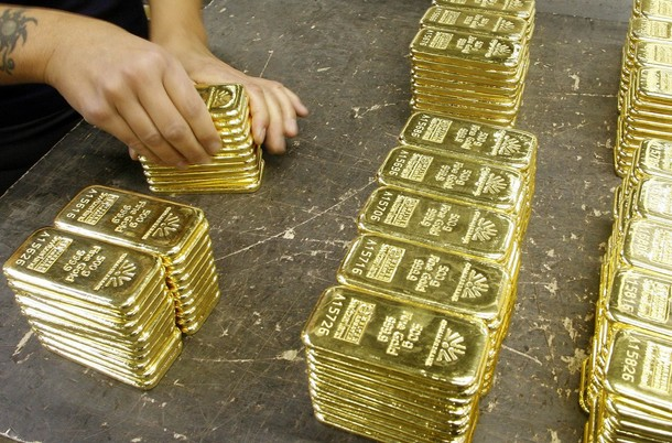 gold-bars Gold futures rose above $970 an ounce on Tuesday,