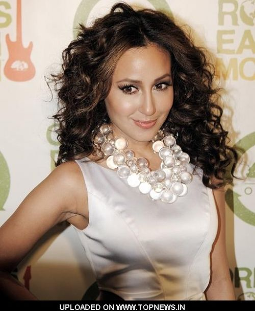 Adrienne Bailon at 2nd Annual Origin Rocks Earth Month Concert