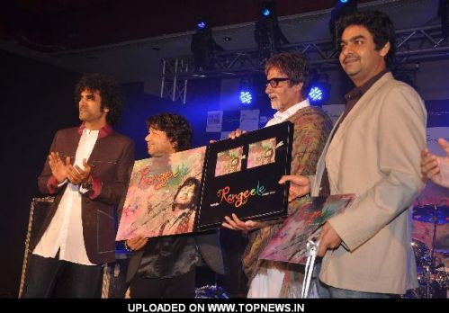 "Bollywood actor Amitabh Bachchan listen to Indian singer Kailash Kher during the release of his new album ""Kailasha Rangeele"""