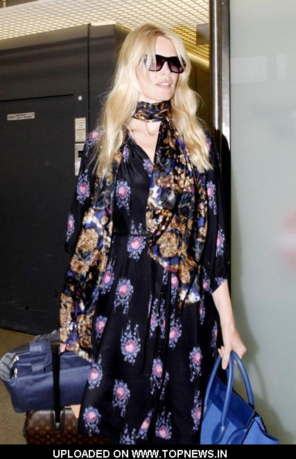 Claudia Schiffer arriving at Tegel Airport after flying in from London for the Vogue Berlin Fashion Night Out
